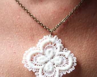 Necklace with white lace pendant.