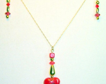 N073 Tiny red heart  on gold chain 16 inches