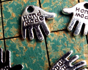 240 tiny hand shaped charms, say HAND MADE, small metal hang tags, great on your handmade items