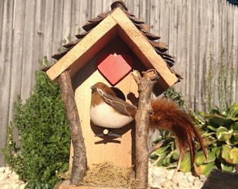 Decorative miniature arts and crafts birdhouse.