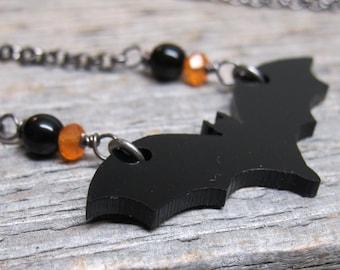 Halloween Batty necklace ... black acrylic bat with carnelian and onyx