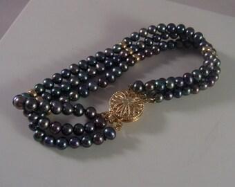 14k Gold and 3 Strand Pearl Bracelet