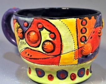 orange planets mug