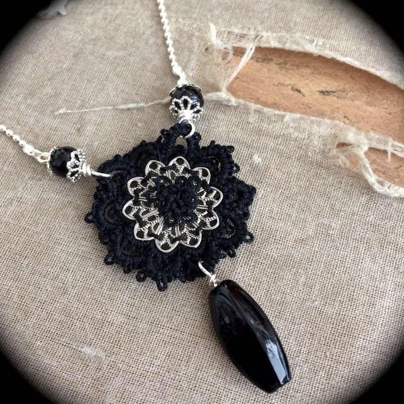 https://www.etsy.com/listing/173262673/black-and-silver-one-of-a-kind-tatted?
