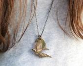 so i fly . a brass bird necklace