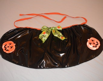 Black pvc vinyl Halloween skirt apron with reflective pumpkins large to extra large dog skirt, trick or treat bow