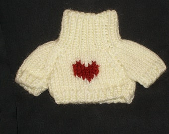 Knitted sweaters for teddy bears or any similar sized doll