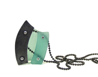 Oxidized Steel and Aqua Resin Riveted Pendant Necklace -  Concoction