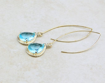 Baby Blue Glass Earrings With A Shiny Gold Plated Frame