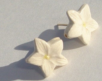 Plumeria Pierced Post Earrings petite white with yellow center ceramic plumeria flowers made in Peru pierced post hand made earrings