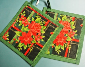 Larger thicker quilted rose flower pattern pair of potholders made of dark green/ red cotton fabric