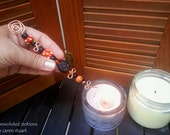 orange and black beaded hammered copper handmade wickwand candle snuffer