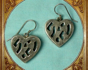 Vintage sterling silver abstract cut-out heart earrings.