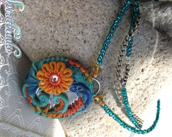 Crystal Sea Flower Garden Mirror Polymer Clay Pendant Necklace yellow orange flower, Aqua Blue