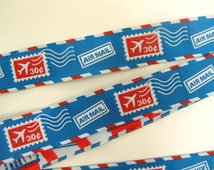 2 yards AIR MAIL STAMPS Jacquard trim in red, white on turquoise. 7/8 inch wide. 987-a