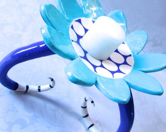 whimsical blue pottery Candleholder, ceramic dish with long curly black & white striped legs