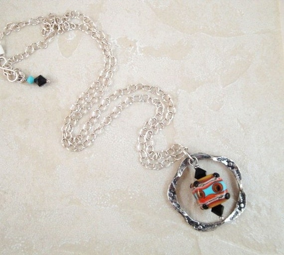 Southwestern style pendant necklace in fine silver with glass cube bead.