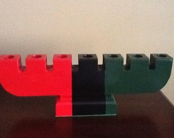 Wooden Kinara for Kwanzaa. Red, Black and Green