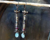 Romans. Ancient beads in caged earrings with apatite gemstone briolettes.
