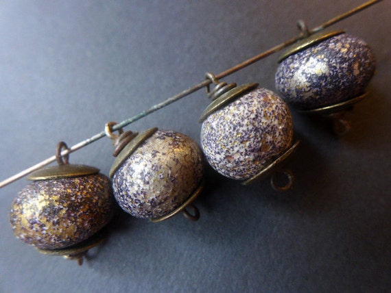 Crusty Glam. 4 dark polymer clay artisan bead links with gold and black speckles and antiqued bronze caps.