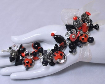Festive Black & Red Dangle Bracelet