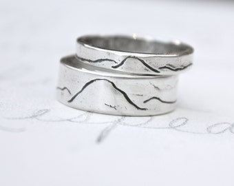 rustic mountain wedding band ring set . ecofriendly recycled silver thin and wide mountain landscape bands rings . unisex alternative rings