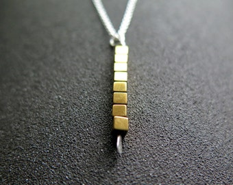 gold and silver necklace. mixed metal jewelry. modern jewellery