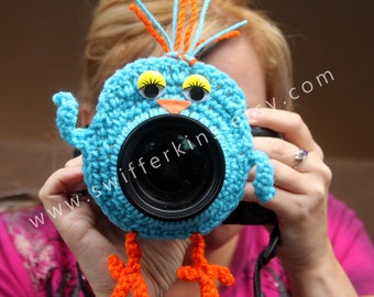 Camera lens buddy. Crochet lens critter blue bird. Photographer helper.