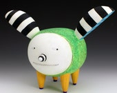 Green Art Dog Sculpture with black and white striped ears