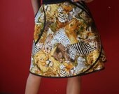 Wrap Skirt, animal print (one size fits most small - large) with pocket.