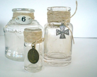 Vintage Bottle Trio with Religious Medals and Numbers