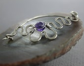 Sterling silver shawl pin or brooch in curly snake with wrapped round amethyst stone
