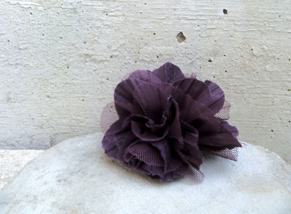 Flower brooch in violet. Fabric brooch in purple similar to a peony with tulle inserts