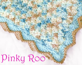 Crochet Baby blanket in a variegated blue and beige colors