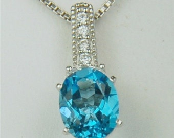 Swiss Blue Topaz Necklace Sterling Silver 9x7mm Oval 2ct With Oval and Round Cz's
