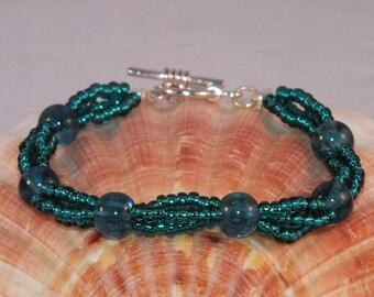 Teal Coloured 3 Strand Beaded Bracelet