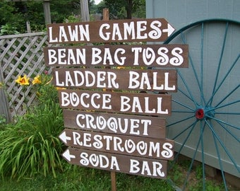 lawn game signs / yard game signs / outdoor weddings / corn hole sign / ladder golf sign / rustic wedding signs / back yard game signs