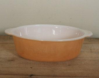 peach lustre ware oval casserole dish by fire king