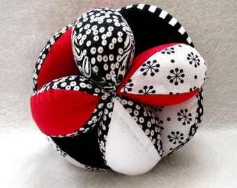 Black, White, and Red Plush Grab Ball