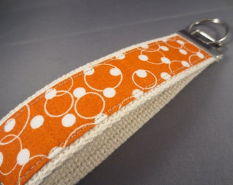 Keychain Fob -- Orange Dot and Swirl on Cream Webbing