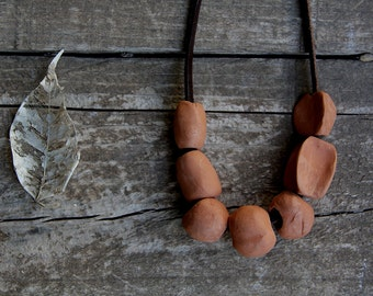 Simple clay necklace on genuine leather chord