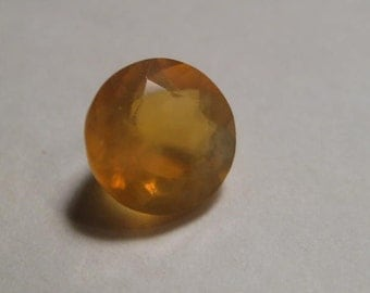Natural   Mexican  Opal  ....  faceted Round ....  7.8  mm round x  5.3  mm ..  a4503