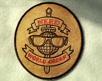 """Nerd World Order Iron on Patch on Cowhide Leather 3 7/8"""" x 4 1/4"""""""