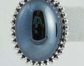 Silver Bezel and Blue/Black Hemitite Cabachon Stone Pierced Earrings