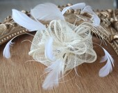 Cute   ivory color    flower  with feather  clip  back 1 piece listing big size