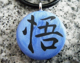 "Japanese kanji symbol ""ENLIGHTENMENT""  hand carved on a polymer clay blue pearl color background. Comes with a FREE necklace"