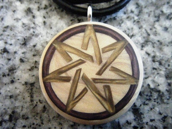 7 Pointed Heptagram Fairy Star hand carved on a polymer clay light gold color background. Pendant comes with a FREE 3mm necklace