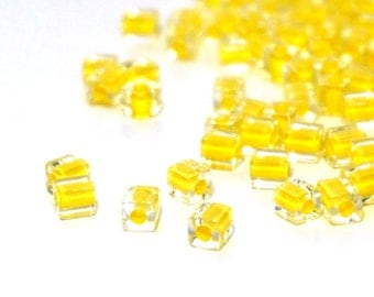 4mm square glass beads,  clear with yellow color lined hole, Miyuki cubes, 200 beads 994SB