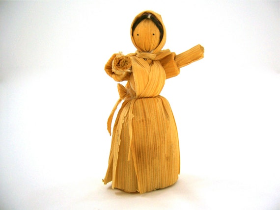 Vintage corn husk doll crafted from natural corn husk, for delicate play or to decorate a small space.