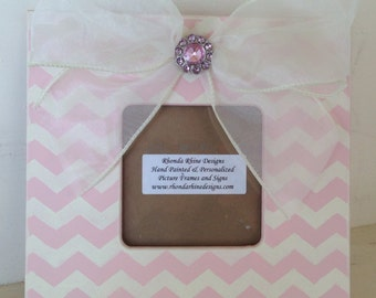 Pink and ivory chevron frame with jeweled bow